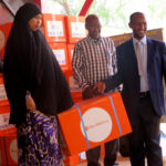 Dr Ali Sheikh of the Ministry of Health presents the midwifery kits